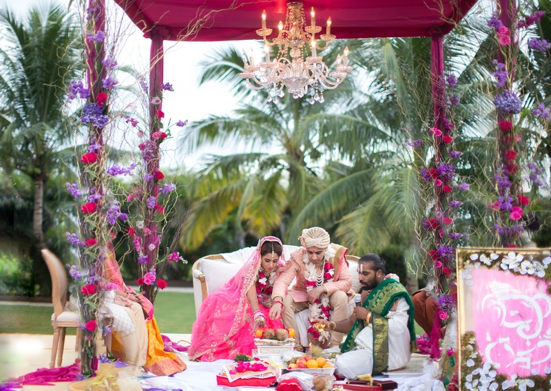 traditional indian hindu wedding ceremony under mandap with chandelier