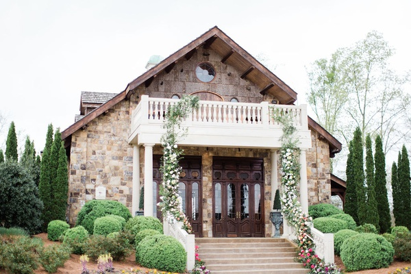 2400 on the river wedding, reception lodhe with floral garland cascading down balcony