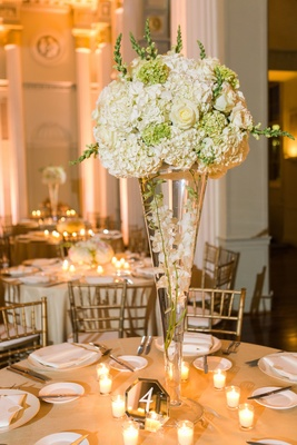 floral centerpiece with glass vase hydrangeas roses white ivory orchids greenery candles mirror