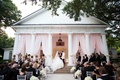 Wedding ceremony on porch of venue outdoor ceremony lee park arlington hall pink drapery