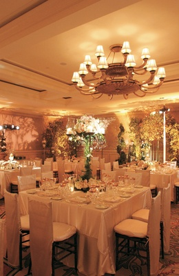 Wedding reception with white tables and candelabra centerpieces