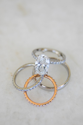 Wedding rings groom's polished platinum band bride oval cut pave engagement ring and rose gold band