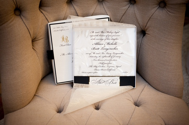 White and black invites with sheer paper overlay