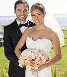 Bride in strapless scallop Casablanca Bridal gown with groom in tuxedo and rhinestone dotted bouquet