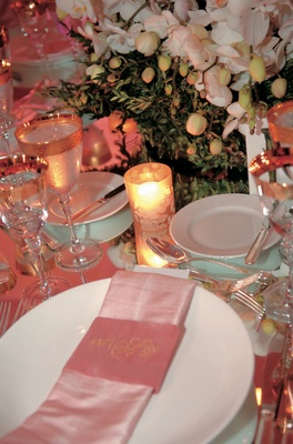 Mirror tabletop with pink napkin at wedding reception