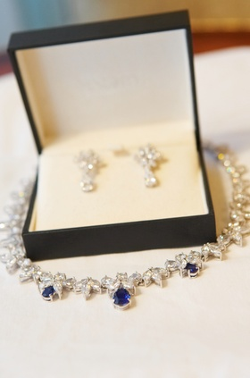 Jewelry box with diamond earrings and sapphire necklace