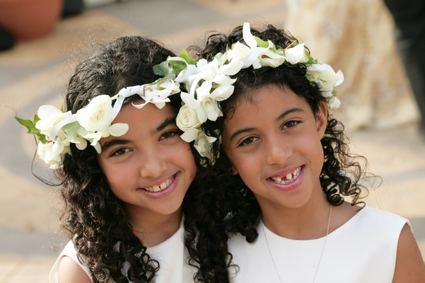 Curly hairstyles with crown of flowers on head