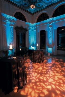 Blue uplighting and orange pattern gobo lighting