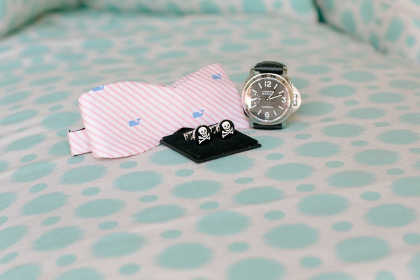 Groom's wedding day accessories light pink and white stripe bow tie skull cufflinks and watch