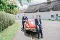 red vintage car english british groom groomsman transportation blue suits tuxedos england uk wedding