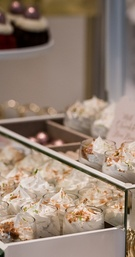 Some desserts were displayed on white cake stands and other placed in agates; showcased like delicat