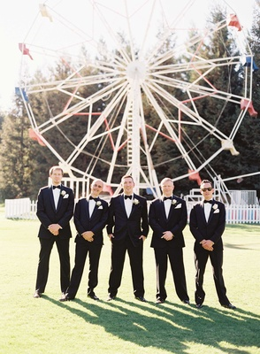 Groomsmen in tuxedos with bow ties at Calamigos Ranch ferris wheel