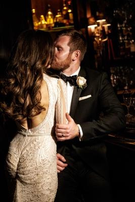 Wedding couple portrait keyhole back inbal dror wedding dress groom in tuxedo and rose boutonniere