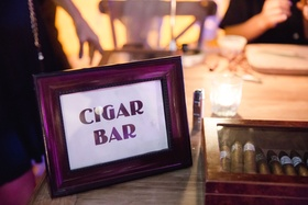 Sign with Cigar Bar in frame next to cigars Mexico wedding reception