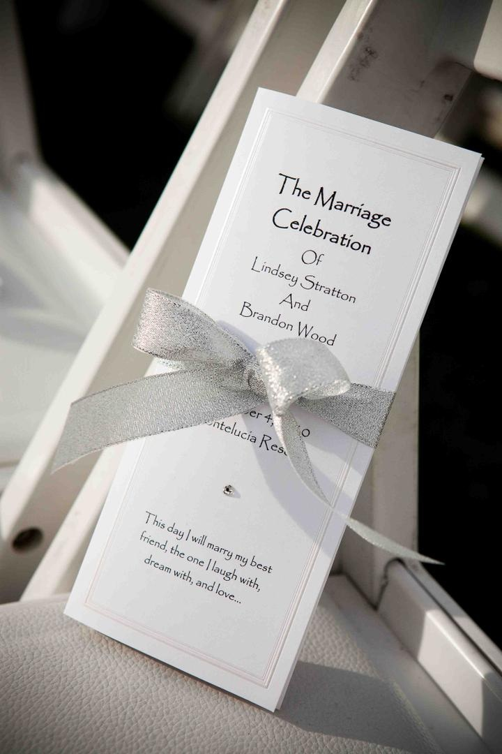 Silver ribbon around rectangular ceremony booklet
