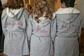Bride and bridesmaids in grey plush robes
