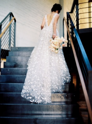 Wedding dress v back going up stairs galia lahav star embroidery a line wedding dress bouquet