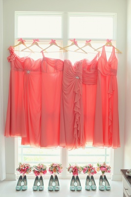 bbb674cc579ab ... Bridesmaid dresses in different styles on hangers above mint heels and  bouquets ...