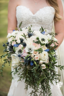 bouquet with lots of greenery, anemone, roses, scottish thistle