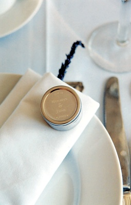 Wedding favors were placed in engraved tins