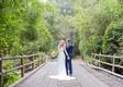 wedding portrait on bridge bride in sleeveless wedding dress groom in blue suit bridge santa barbara