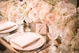 Wedding reception flower centerpiece runner delicate place settings