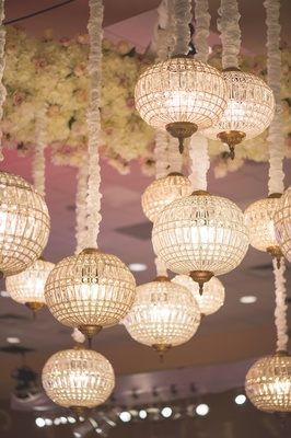 Wedding reception with glass Moroccan-inspired lanterns over dance floor