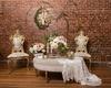 wood floors, vines on brick wall, vintage-inspired chairs