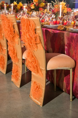 fire-inspired wedding styled shoot, glittery orange decorative chair covers