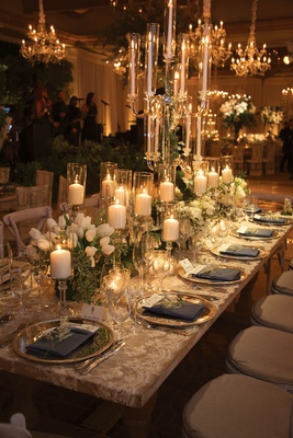 wedding reception table, lace linen, candelabra, pillar candles on crystal stands