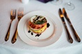 Lyndsy Fonseca and Noah Bean vegan wedding reception meal tomato and vegetable entree appetizer