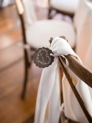 Wedding reception favor pashmina shawl on back of x back wood chair with stay warm tag scallop