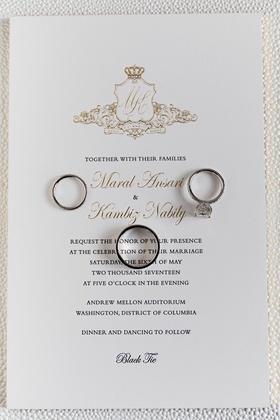 Black tie wedding invitation gold monogram crest with crown wedding rings on top