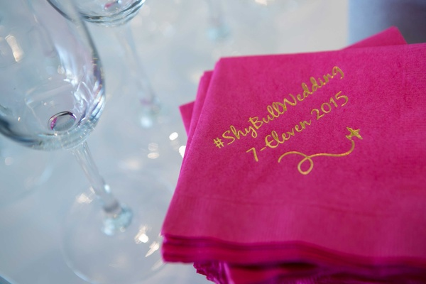 a couples wedding hashtag a fun play on their new shared last name gold calligraphy hot pink napkins