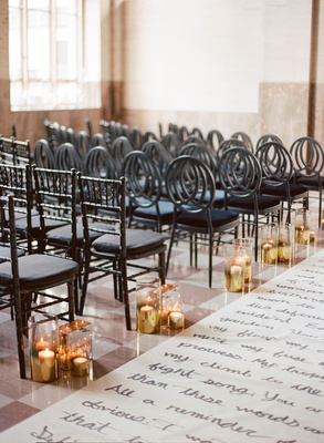 Wedding ceremony handwritten poems and love letters on aisle runner canvas black chairs round