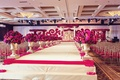 south indian-american wedding ceremony, elevated aisle line with arrangements of fuchsia flowers