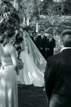 Black and white photo of bride's trailing veil