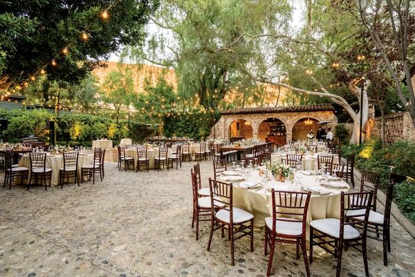 outdoor wedding reception at hummingbird nest ranch, courtyard reception, bistro lights