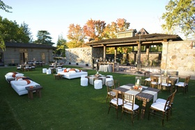 Vintage estate lawn cocktail hour with modern seating
