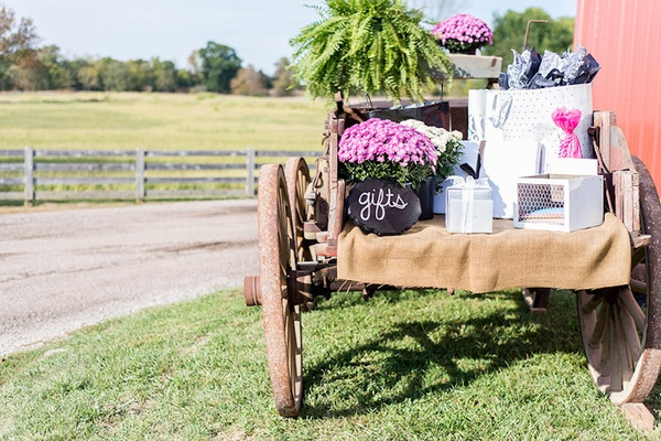 Wedding gifts on rustic wagon at farm wedding