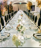 small floral centerpieces line the middle of long reception tables