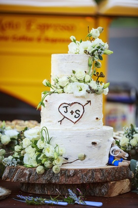 White wedding cake that resembles a tree trunk, has couple's initals carved, St. Louis Rams Rampage