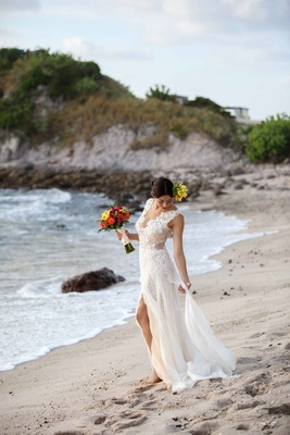 bride fixing ines di santo gown beach punta mita mexico colorful headpiece bouquet shoot morning
