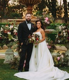Stephanie Perez and Brandon Hampton at greystone mansion wedding ceremony fountain at altar fall hue