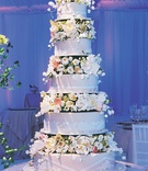Five layer wedding cake with flower tiers and lace details