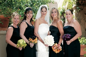 Bridesmaids with mismatched dresses and bouquets