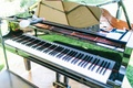 Piano at outdoor wedding ceremony with microphone for performance