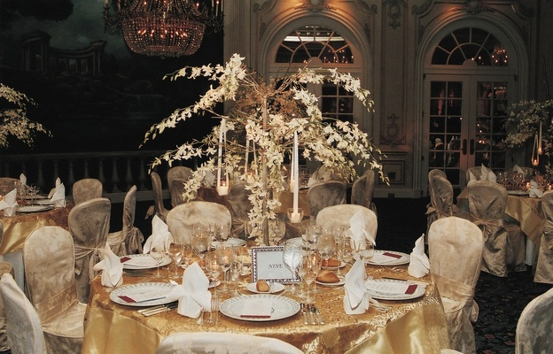 Yellow tablecloth topped with orchid tree