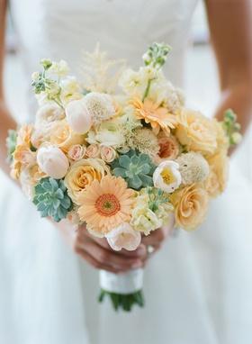 Wedding bouquet daisy rose succulent tulip ranunculus peach orange green white yellow pink