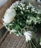 Bride's bouquet of white and green flowers and greenery